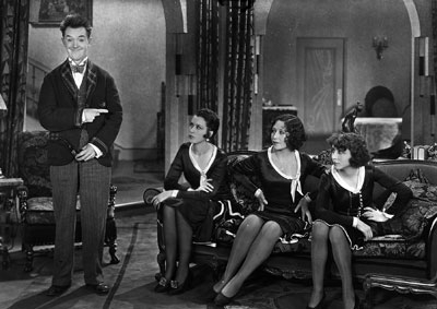 Stan Laurel and the actresses who play his wife.