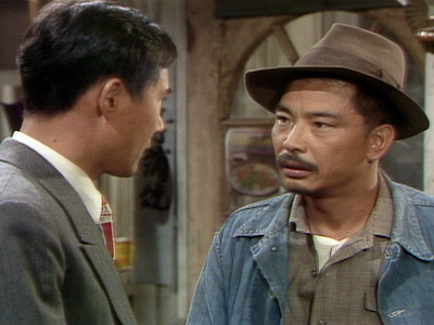 Two Japanese American men talking to each other.