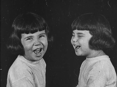 Two smiling Baby Peggys (as twins).