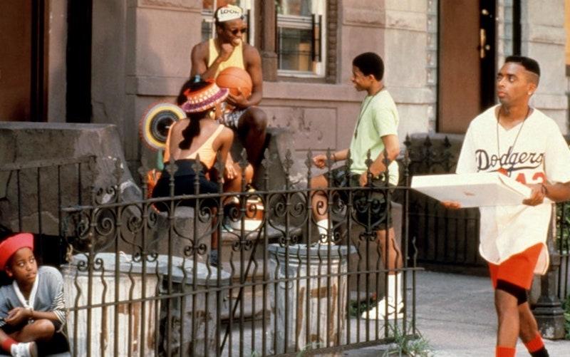 Actor Spike Lee walking through a Bed-Stuy neighborhood.