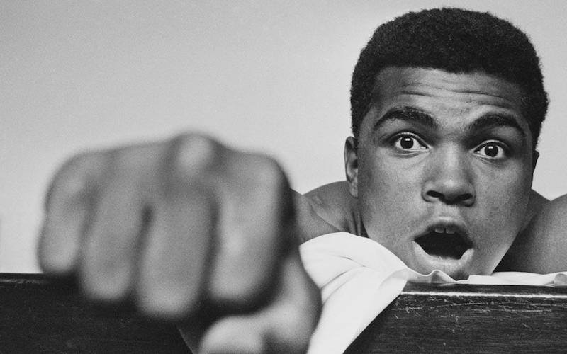 Muhammad Ali extending his right fist.