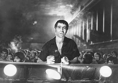 An unhappy-looking man in a theater.