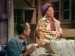 A Japanese American woman cloaked in a kimono as she packs her belongings with a family member.